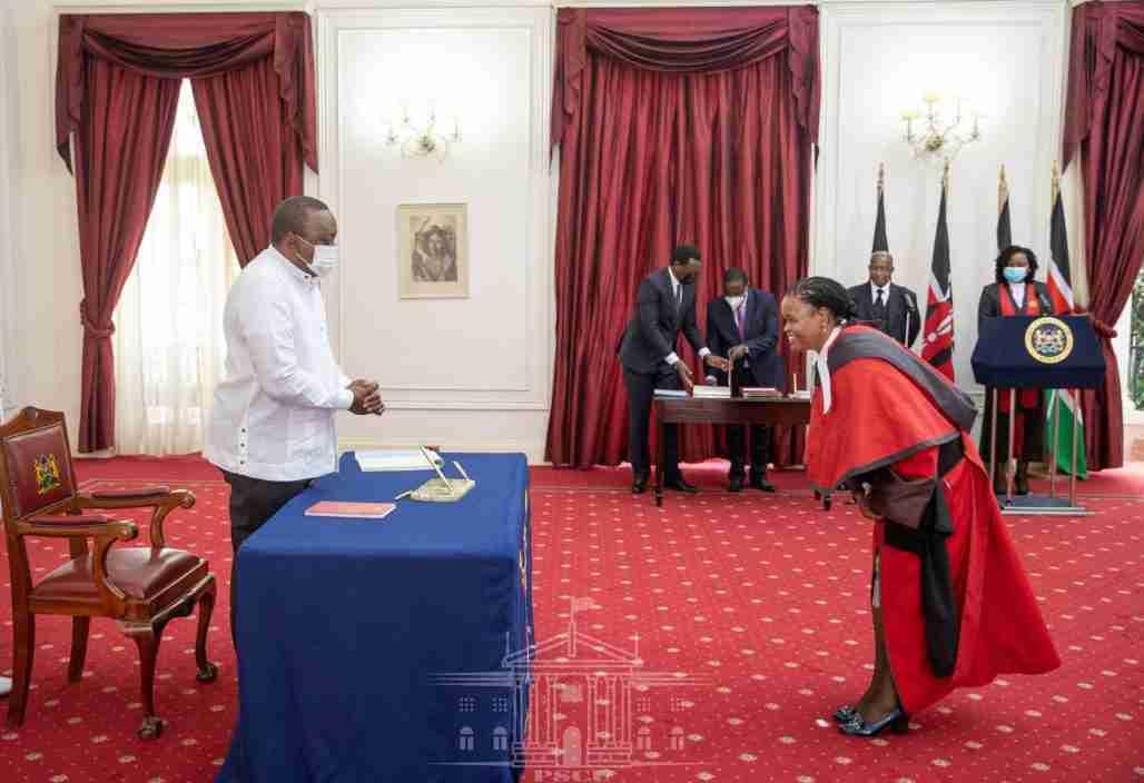 Martha Koome bows to Kenya's president Uhuru Kenyatta
