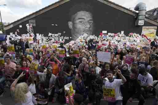 marcus rashford racism mural take knee demonstration